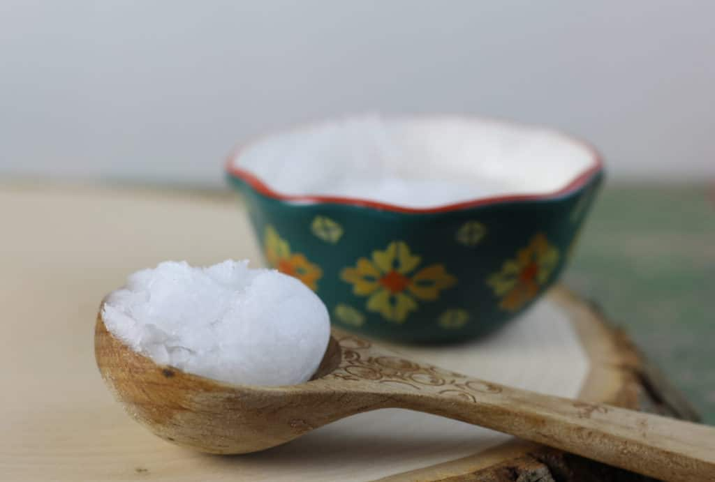 Microdermabrasion Scrub Recipe on a wooden spoon